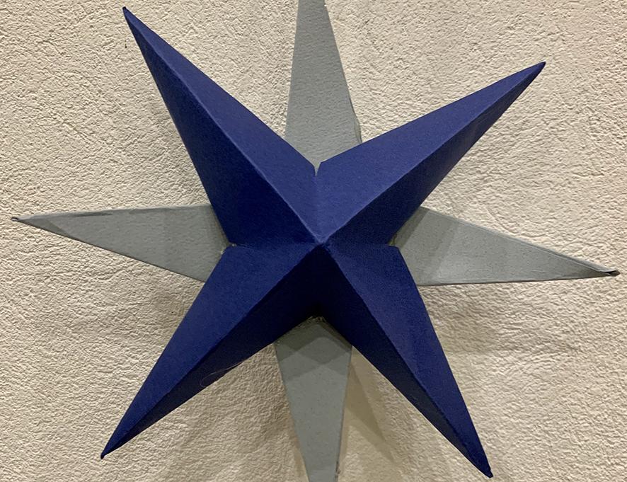 Självgjorda pappersstjärnor att pynta med